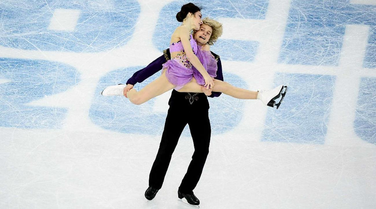 Meryl Davis and Charlie White scored 116.63 in their free dance to beat Canadian rivals Tessa Virtue and Scott Moir and win the first U.S. Olympic gold in ice dancing.