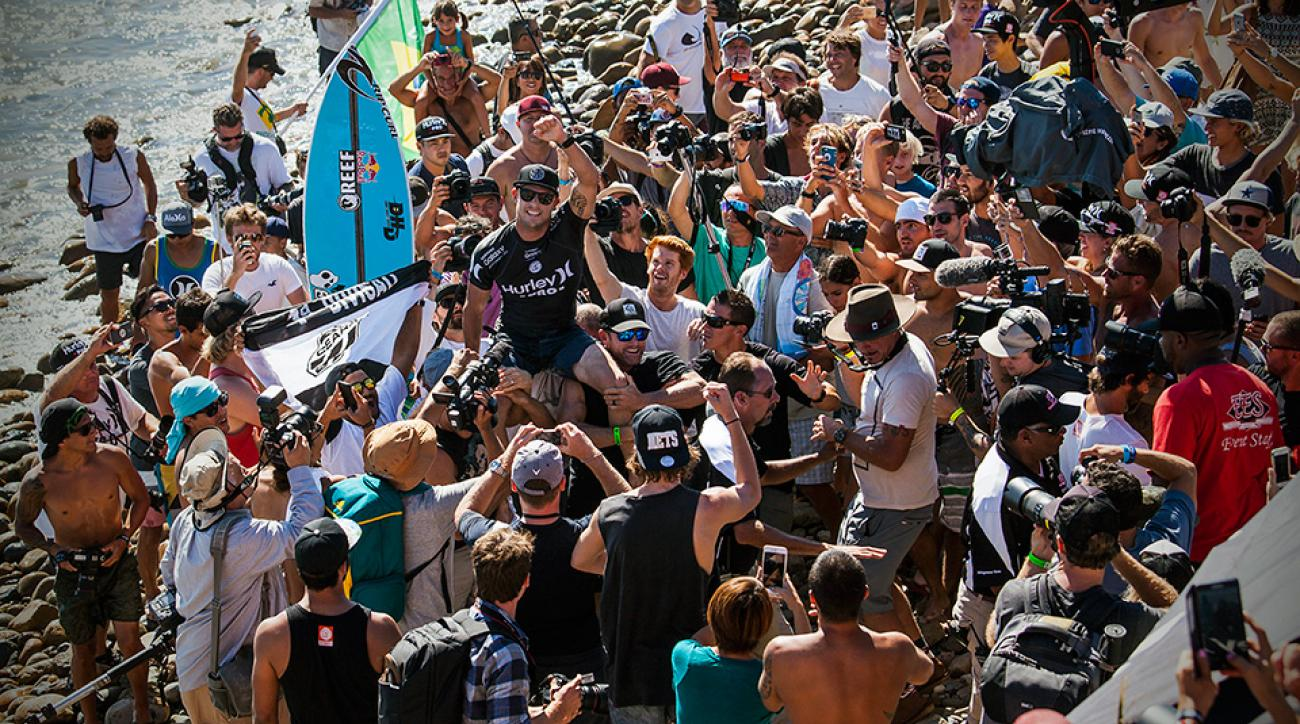Mick Fanning (center) celebrates his victory at the Hurley Pro in Lower Trestles, Calif.