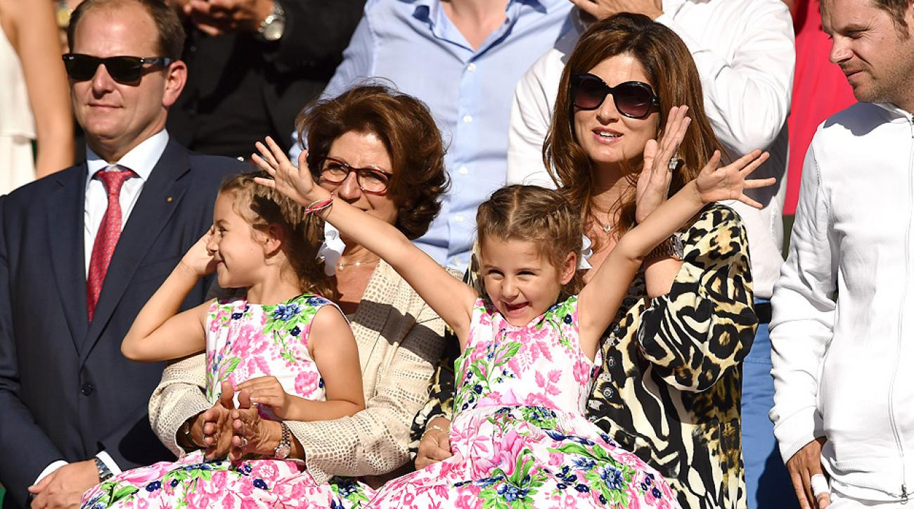 Mirka Federer, Roger Federer's wife, watches the Wimbledon final with the couple's twin girls, Myla Rose and Charlene Riva.