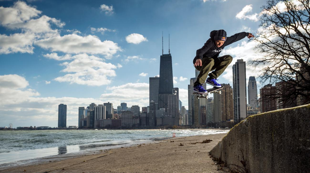 """Well known for his """"manual tricks,"""" Joey Brazinski, an American street skateboarder, performs an ollie in front of the Chicago skyline."""