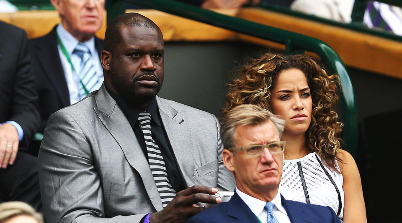 Shaquille O'Neal enjoys himself in the royal box in Centre Court at the All England Club.