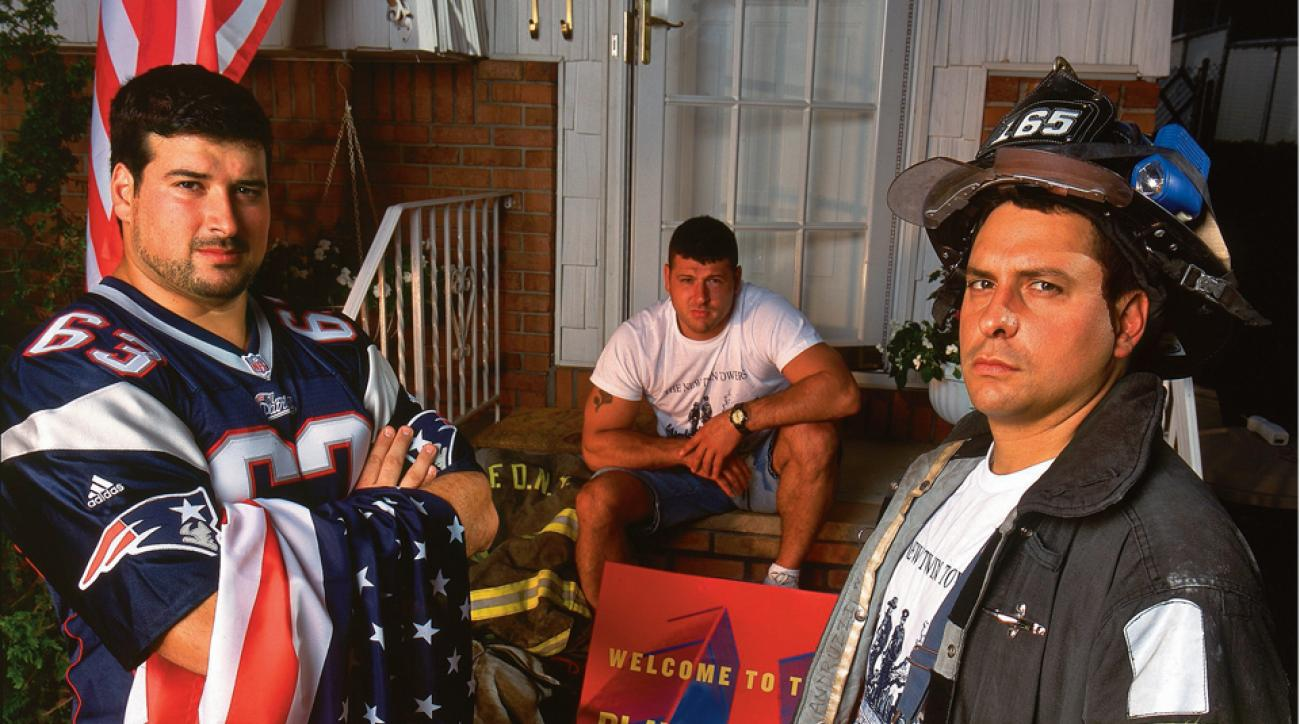 Joe Andruzzi, left, a guard for the New England Patriots, joins his brothers, New York City firefighters Jim, seated, and Bill in front of their family home on Staten Island.