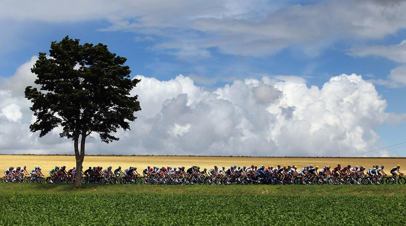 The peloton make their way through the French countryside on stage six of the 2012 Tour de France from Epernay to Metz.