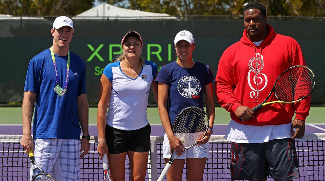 Ryan Tanehill, Nadia Petrova, Katarina Srebotnik and Bryant McKinnie team up to play a doubles match.