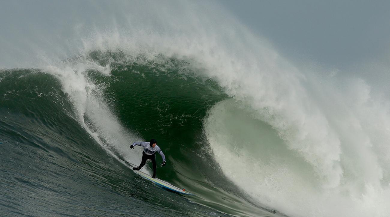 Surfers taking on Mavericks in Half Moon Bay, Calif.