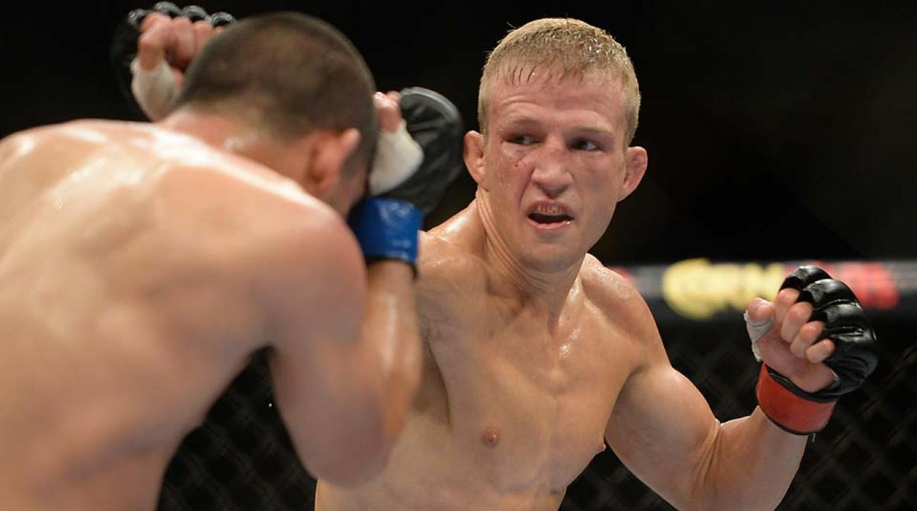 T.J. Dillashaw punches Joe Soto in their bantamweight championship fight at UFC 177 on Aug. 30 in Sacramento.