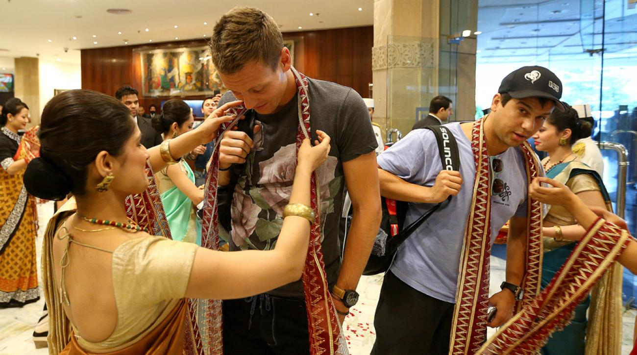 Singapore Slammers player Tomas Berdych receives a traditional welcome as he arrives at his hotel in Delhi before the third leg of the IPTL.