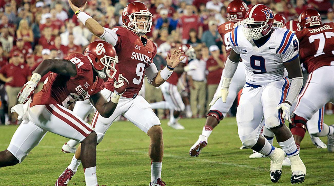 Louisiana Tech DL Vernon Butler (No. 9) pressures Oklahoma QB Trevor Knight.