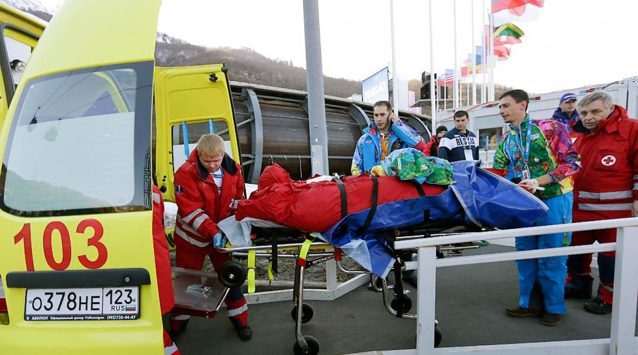 A track worker at the Sanki Sliding Center was loaded into an ambulance after getting hit by a bobsled Thursday.