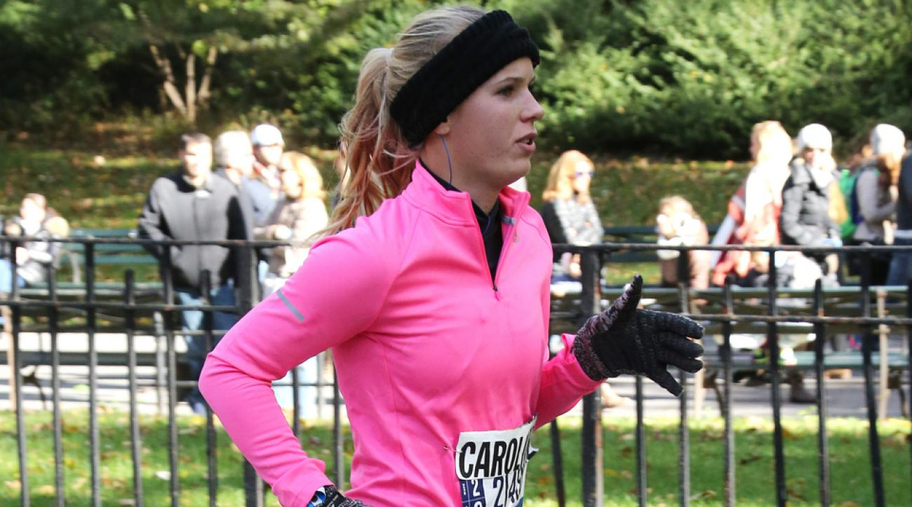 Wozniacki finished the 26.2 mile race in 3 hours, 26 minutes, 33 seconds.