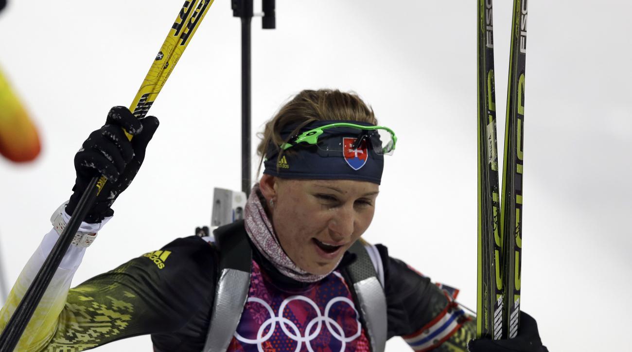 Slovakia's Anastasiya Kuzmina smiles after completing the women's biathlon 7.5k sprint, at the 2014 Winter Olympics, Sunday, Feb. 9, 2014, in Krasnaya Polyana, Russia. (AP Photo/Kirsty Wigglesworth)
