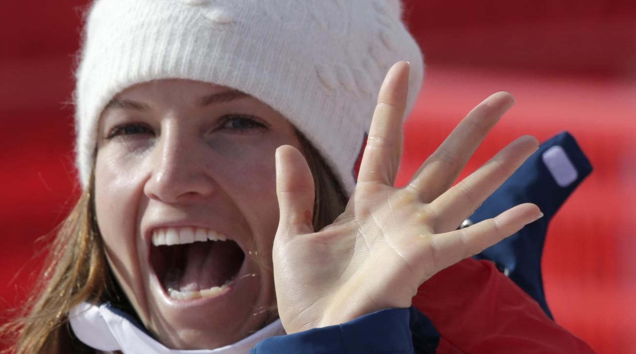 United States' Julia Mancuso waves as she leaves the finish area after the downhill portion of the women's supercombined at the Sochi 2014 Winter Olympics, Monday, Feb. 10, 2014, in Krasnaya Polyana, Russia. (AP Photo/Gero Breloer)
