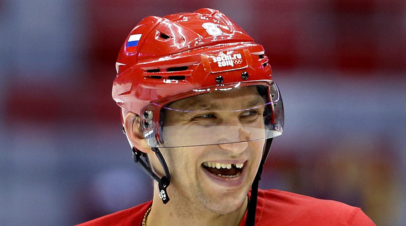 Russia forward Alexander Ovechkin laughs with teammates during a training session at the 2014 Winter Olympics, Monday, Feb. 10, 2014, in Sochi, Russia. (AP Photo/Julie Jacobson)