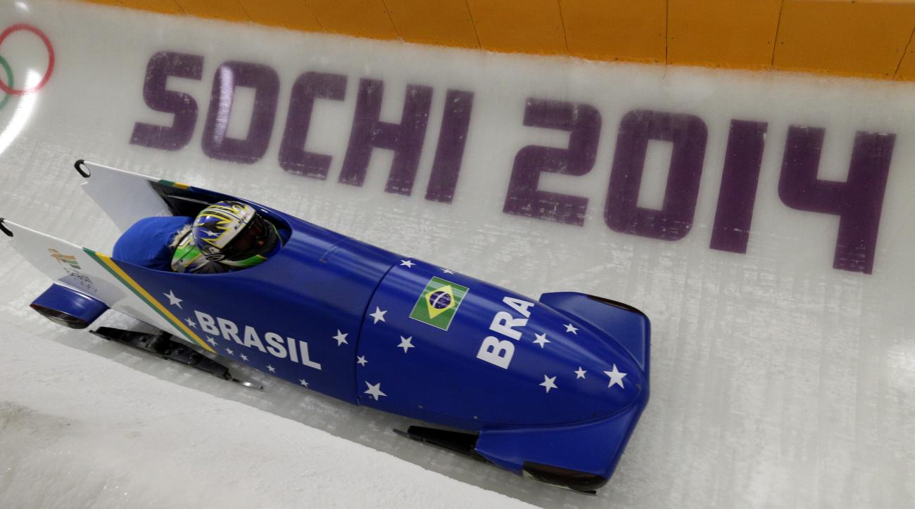 The team from Brazil BRA-1, piloted by Fabiana Santos, takes a curve during a training run for the women's two-man bobsled at the 2014 Winter Olympics, Friday, Feb. 14, 2014, in Krasnaya Polyana, Russia. (AP Photo/Michael Sohn)