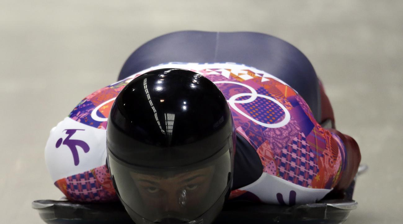 Martins Dukurs of Latvia starts his third heat during the men's skeleton competition at the 2014 Winter Olympics, Saturday, Feb. 15, 2014, in Krasnaya Polyana, Russia. (AP Photo/Dita Alangkara)