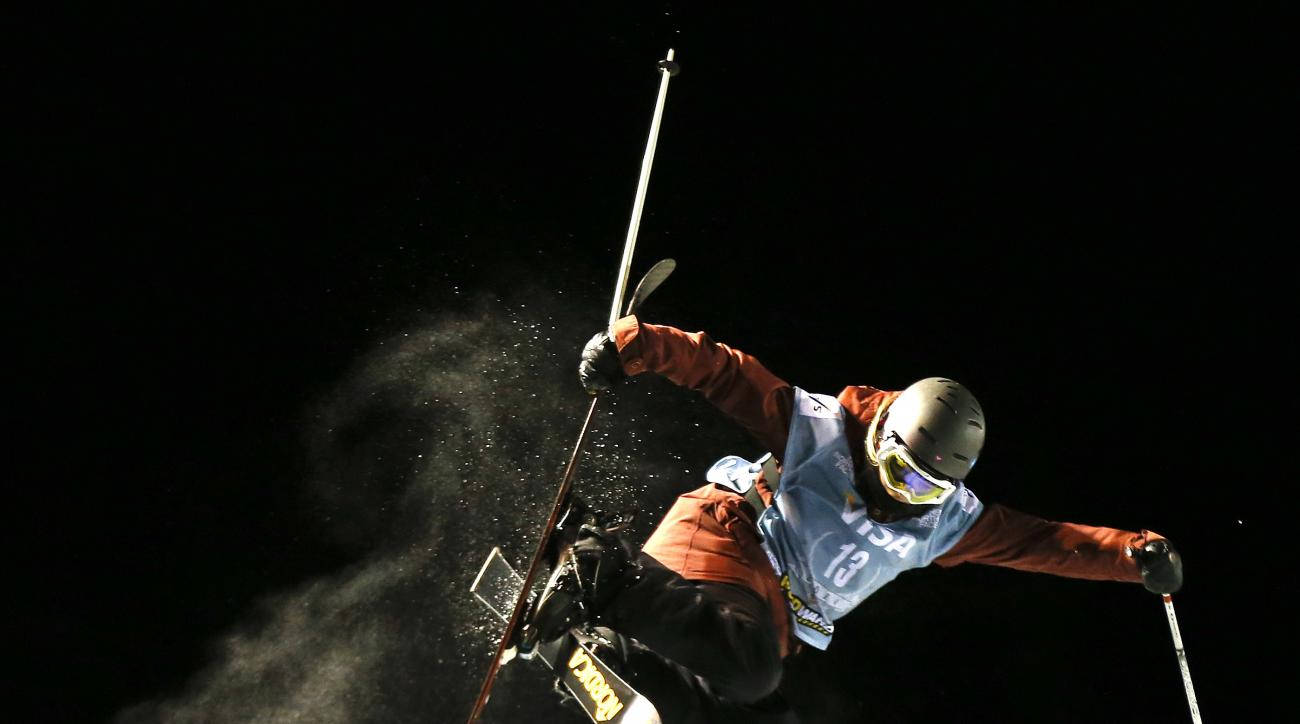 FILE - In this Dec. 19, 2013 file photo, Rowan Cheshire of Britain flies above the lip of the halfpipe during the World Cup U.S. Grand Prix freestyle skiing qualifications in Frisco, Colo. Cheshire sustained a concussion during practice at the Olympics in Krasnaya Polyana, Russia, on Sunday, Feb. 16, 2014. She said in a Twitter message on Monday that she still doesn't remember much from the day before. (AP Photo/Julie Jacobson, File)