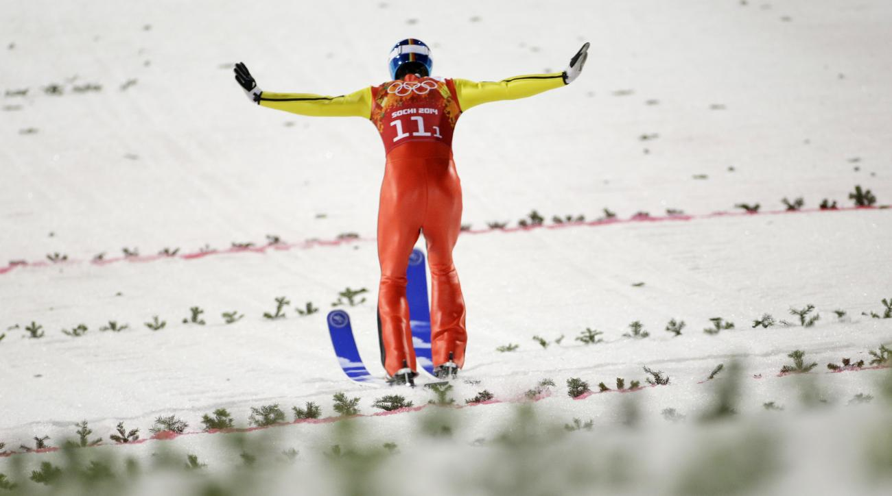 Germany's Andreas Wank lands his second attempt during the ski jumping large hill team competition at the 2014 Winter Olympics, Monday, Feb. 17, 2014, in Krasnaya Polyana, Russia. (AP Photo/Gregorio Borgia)