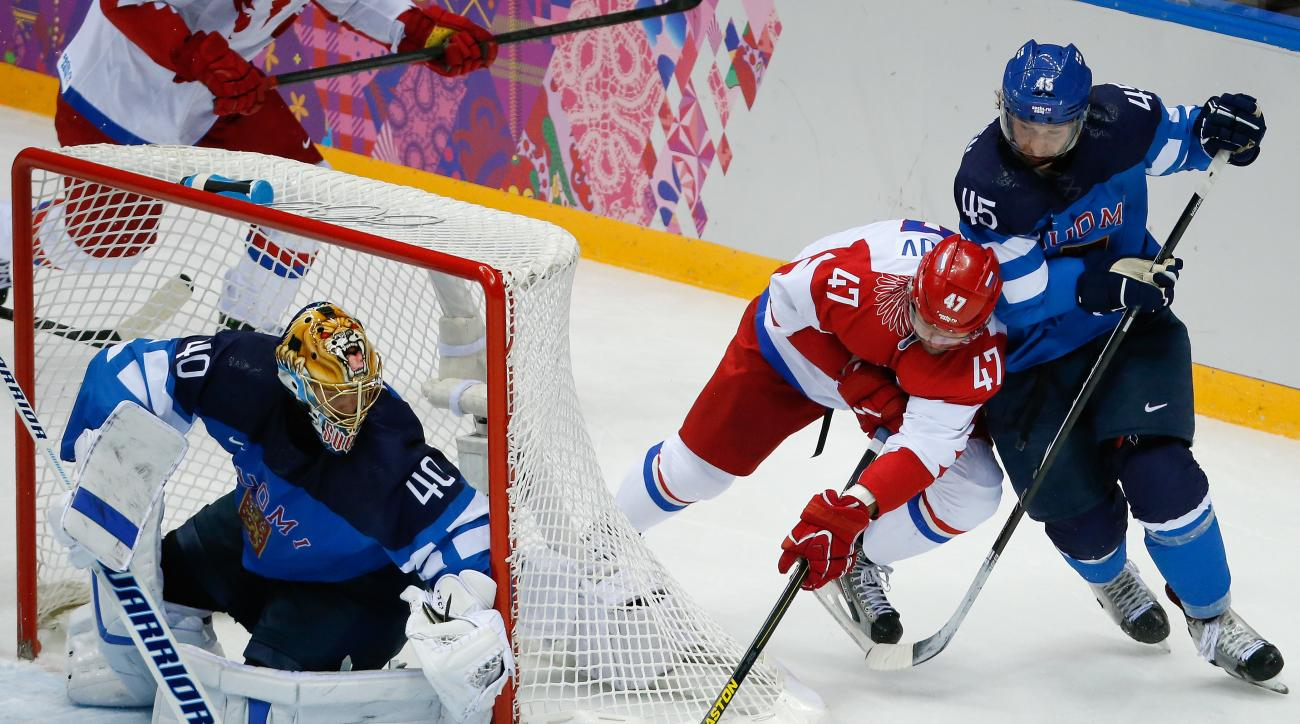 Russia forward Alexander Radulov tries to score against Finland defenseman Sami Vatanen and Finland goaltender Tuukka Rask in the second period of a men's quarterfinal ice hockey game at the 2014 Winter Olympics, Wednesday, Feb. 19, 2014, in Sochi, Russia. (AP Photo/Mark Humphrey)