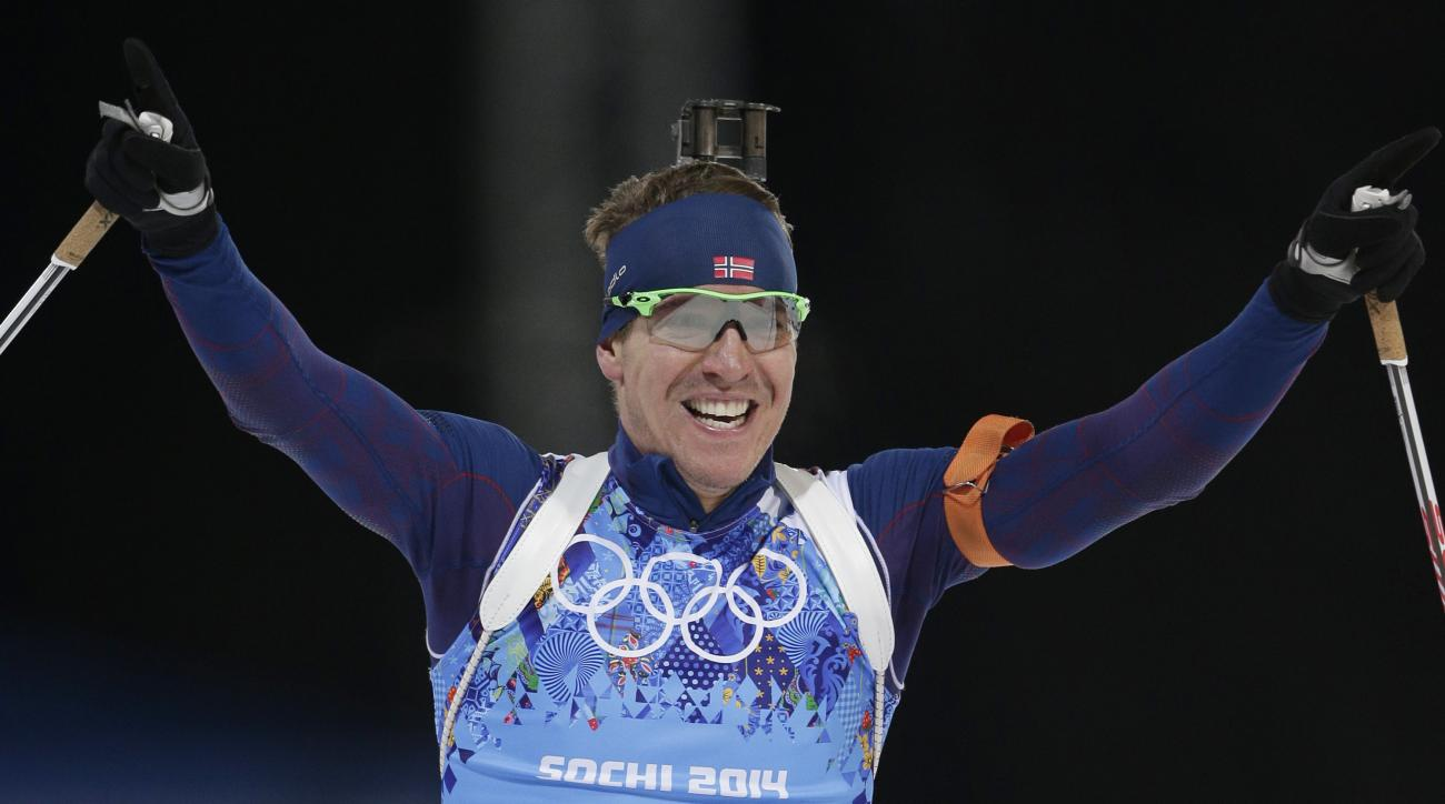 Norway's Emil Hegle Svendsen celebrates winning the gold medal during the mixed biathlon relay, at the 2014 Winter Olympics, Wednesday, Feb. 19, 2014, in Krasnaya Polyana, Russia. (AP Photo/Matthias Schrader)