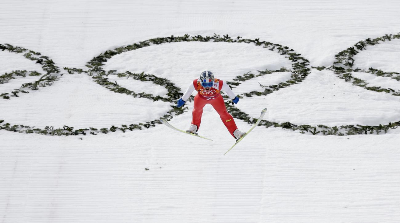 France's Maxime Laheurte makes his attempt during the ski jumping portion of the Nordic combined Gundersen large hill team competition at the 2014 Winter Olympics, Thursday, Feb. 20, 2014, in Krasnaya Polyana, Russia. (AP Photo/Matthias Schrader)