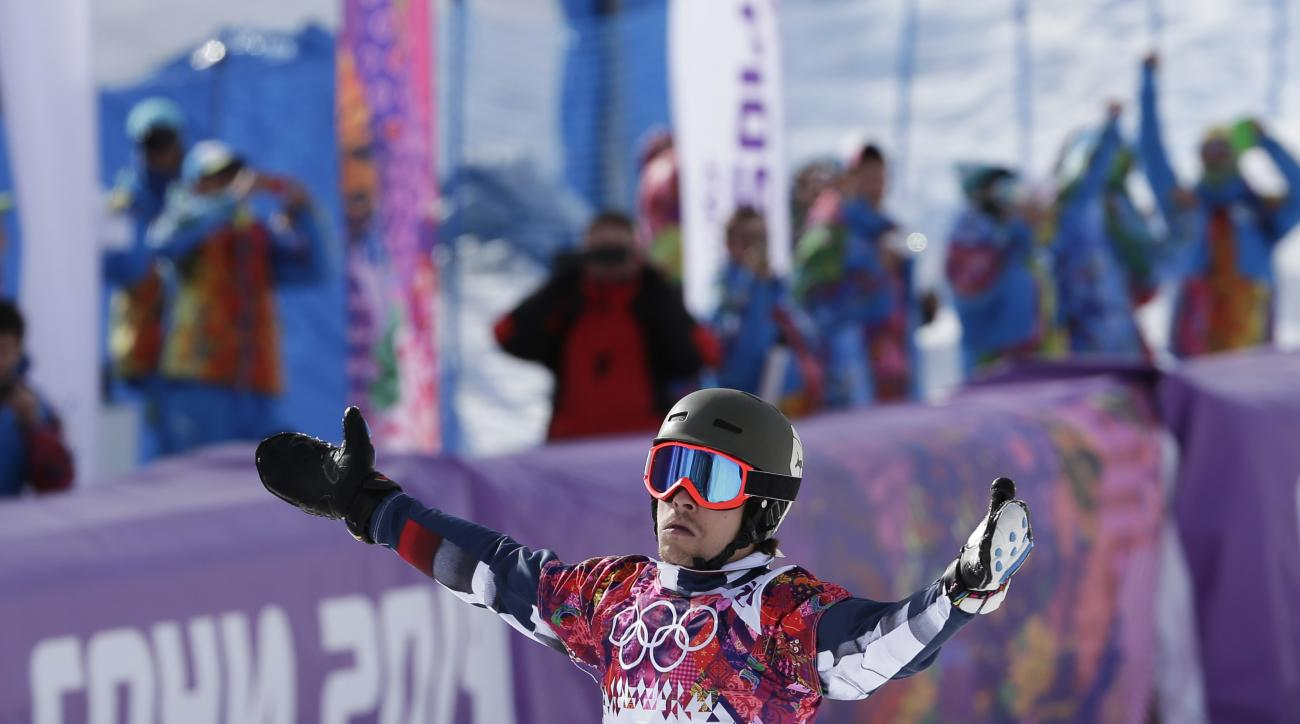 Russia's Vic Wild celebrates his gold medal in the men's snowboard parallel slalom final at the Rosa Khutor Extreme Park, at the 2014 Winter Olympics, Saturday, Feb. 22, 2014, in Krasnaya Polyana, Russia. (AP Photo/Andy Wong)