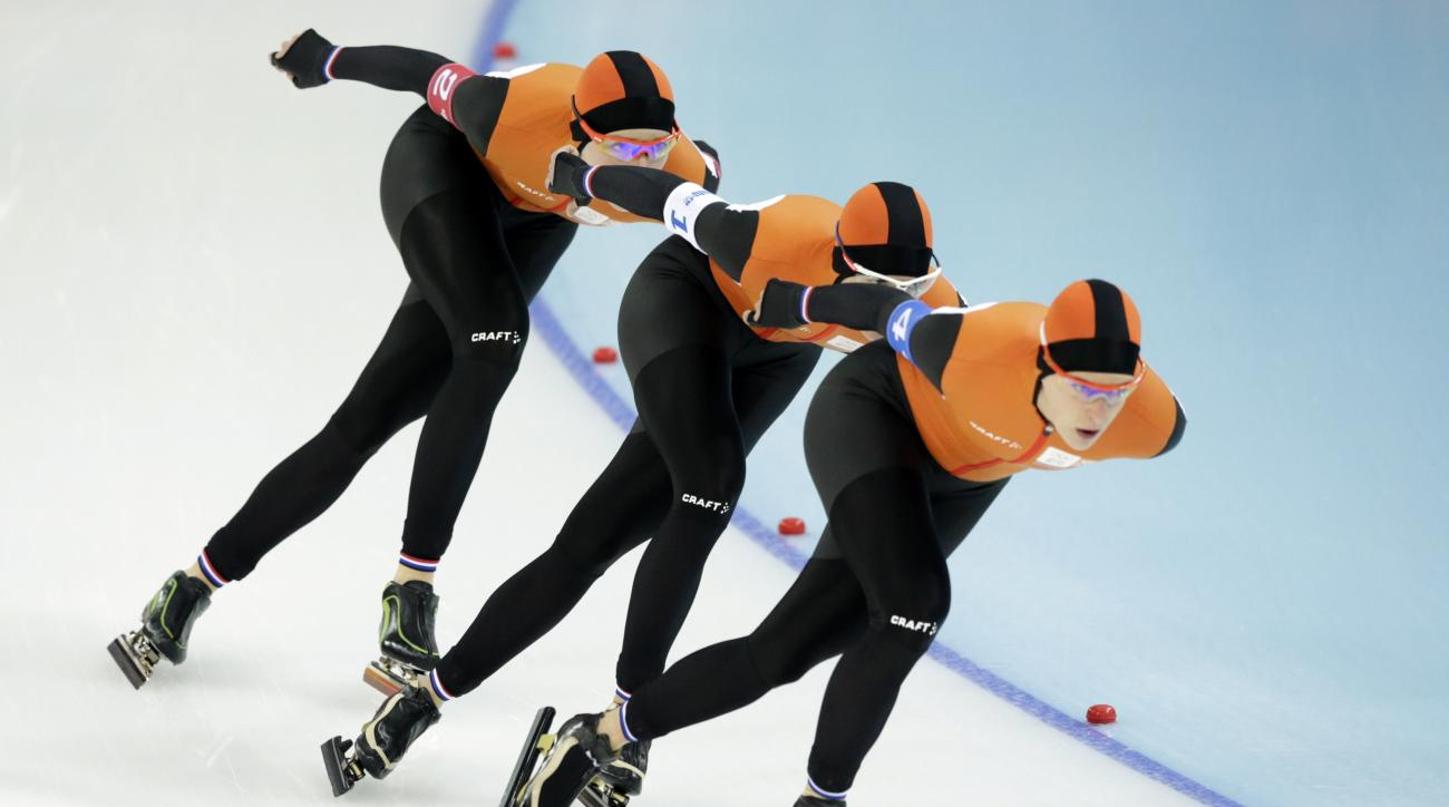 Speedskaters from the Netherlands, left to right, Jorien ter Mors, Marrit Leenstra and Ireen Wust compete in the women's speedskating team pursuit semifinals at the Adler Arena Skating Center at the 2014 Winter Olympics, Saturday, Feb. 22, 2014, in Sochi, Russia. (AP Photo/Matt Dunham)
