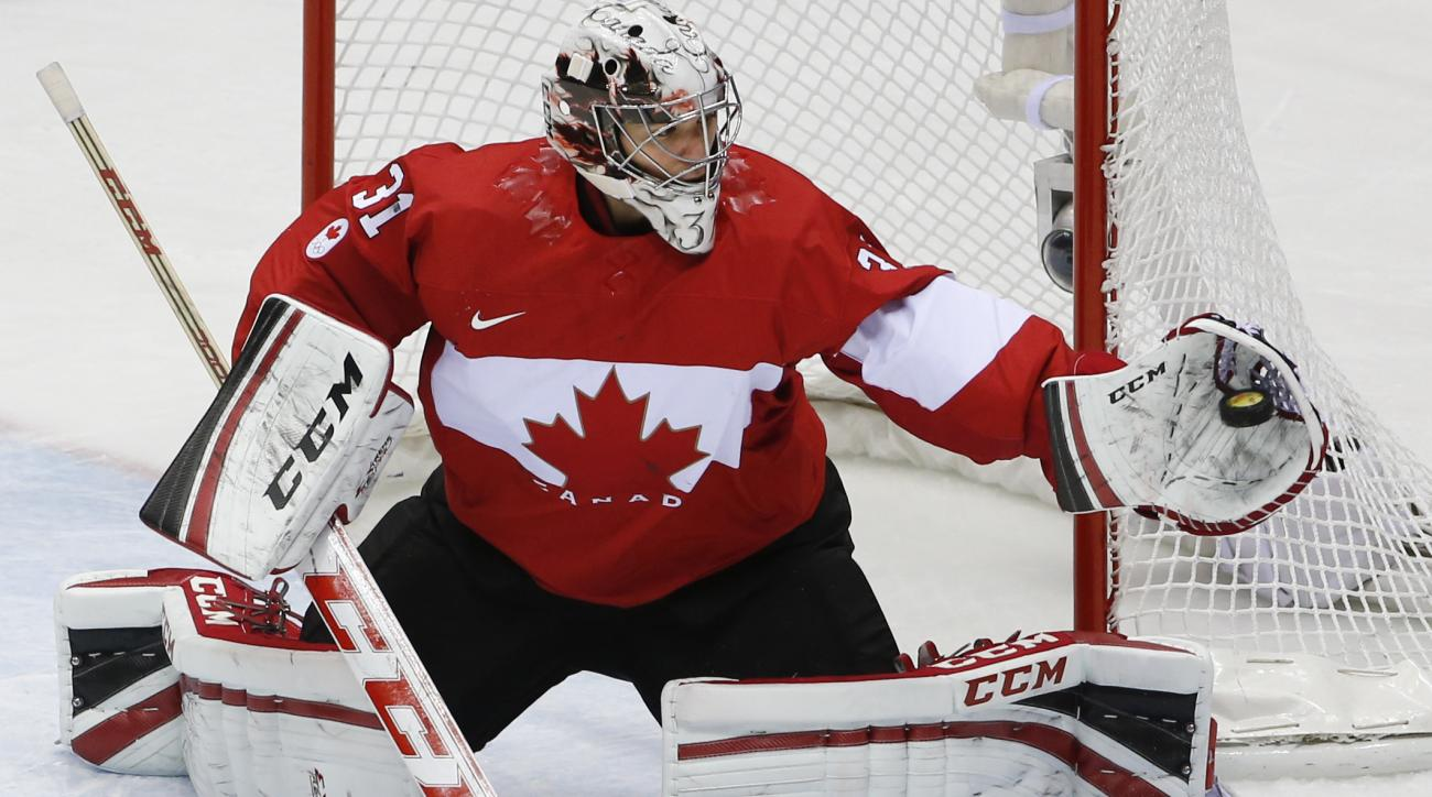Goalkeeper Carey Price of Canada (31) catches a shot on the goal during the second period of the men's gold medal ice hockey game against Sweden at the 2014 Winter Olympics, Sunday, Feb. 23, 2014, in Sochi, Russia. (AP Photo/Petr David Josek)