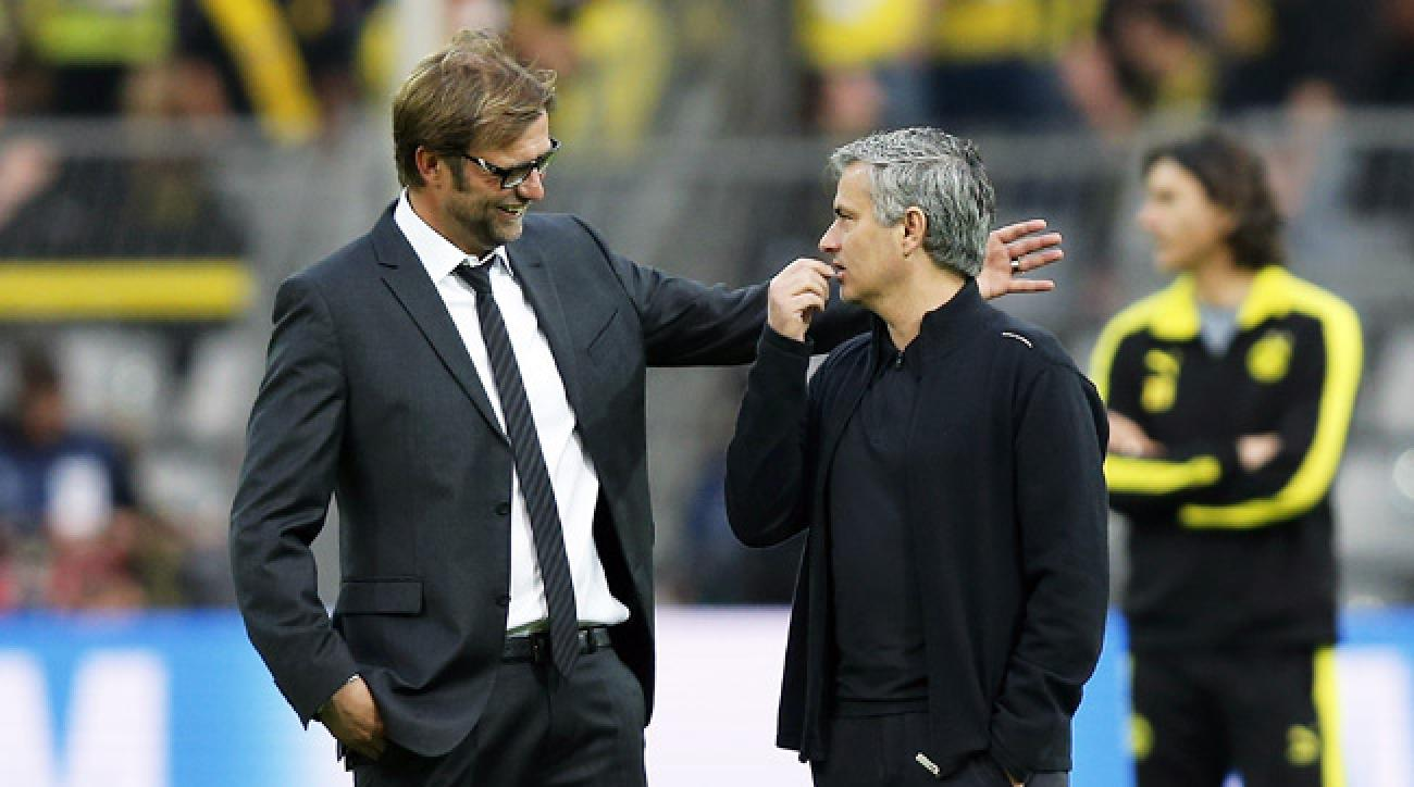 Jürgen Klopp talks with José Mourinho before the first leg of their Champions League semifinal match.