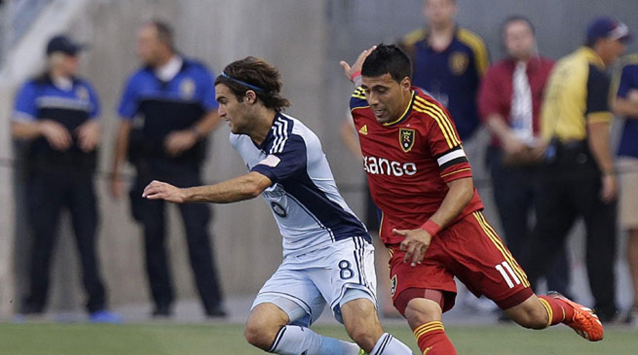 Graham Zusi (left) and Sporting KC claimed temporary MLS supremacy with their win over RSL.