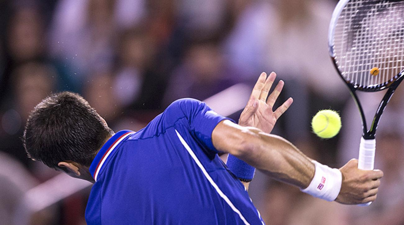 Novak Djokovic recoils after being hit in the chin by Rafael Nadal's shot in the Rogers Cup semifinals.