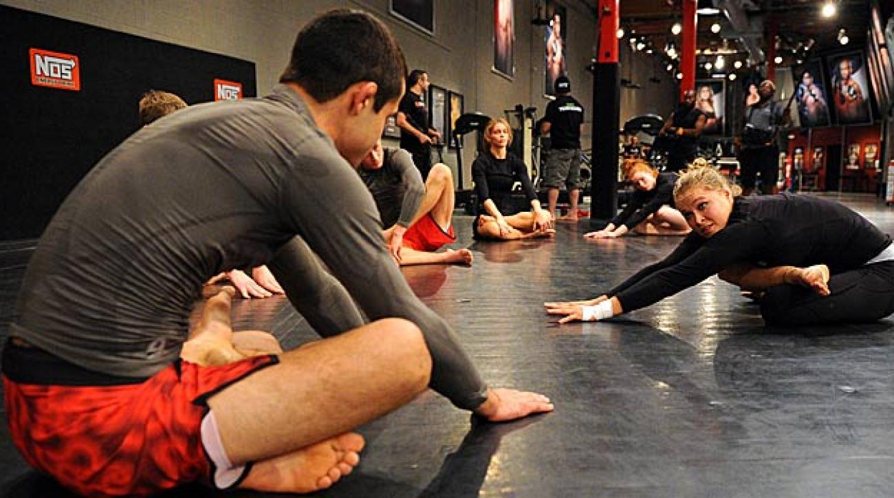Ronda Rousey leads her team in training drills during filming of season 18 of The Ultimate Fighter.