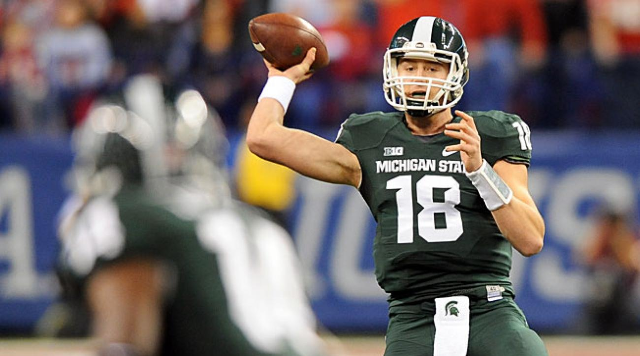 Though he started slowly, Connor Cook (18) helped Michigan State win its final 10 games last season.
