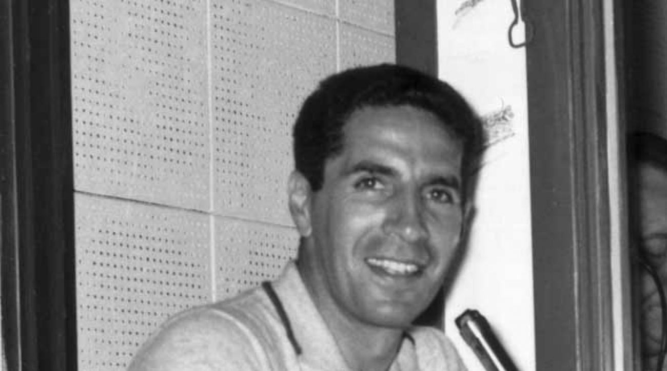 Phil Rizzuto signs as the New York Yankees' new radio and TV announcer.