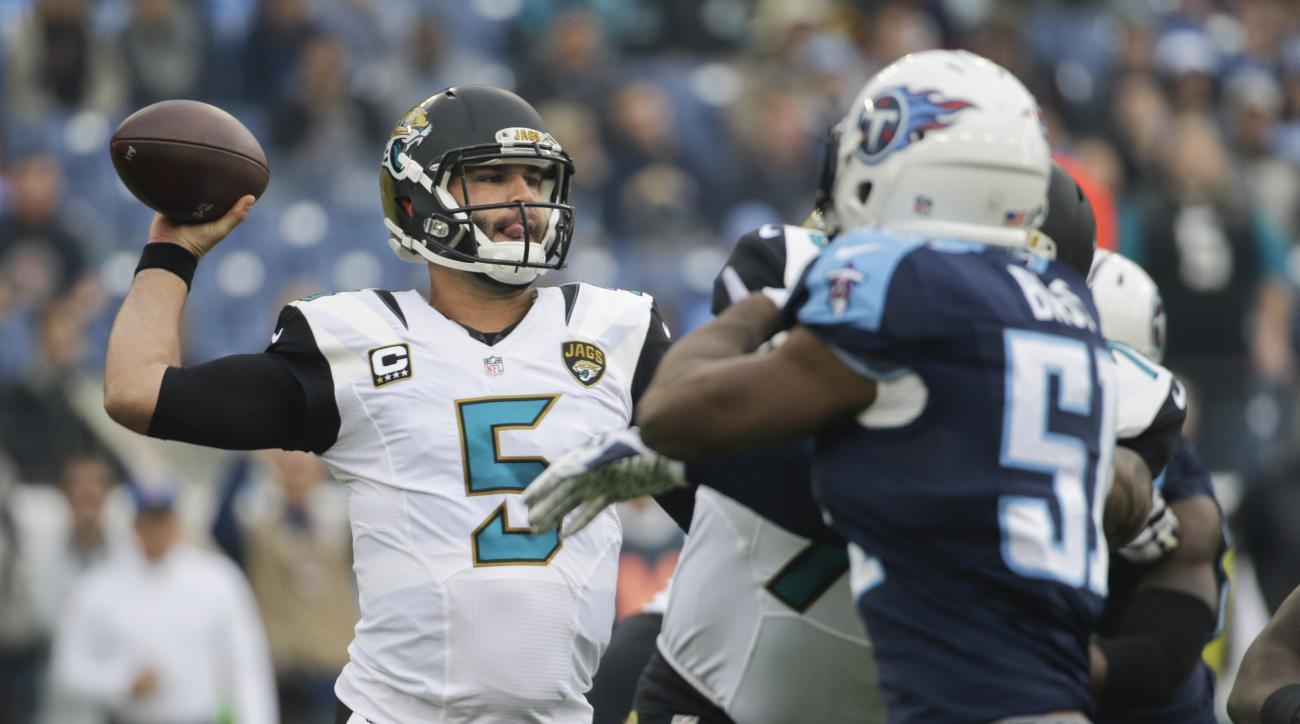 Jacksonville Jaguars quarterback Blake Bortles (5) passes as Tennessee Titans linebacker David Bass (51) rushes in the first half of an NFL football game Sunday, Dec. 6, 2015, in Nashville, Tenn. (AP Photo/James Kenney)