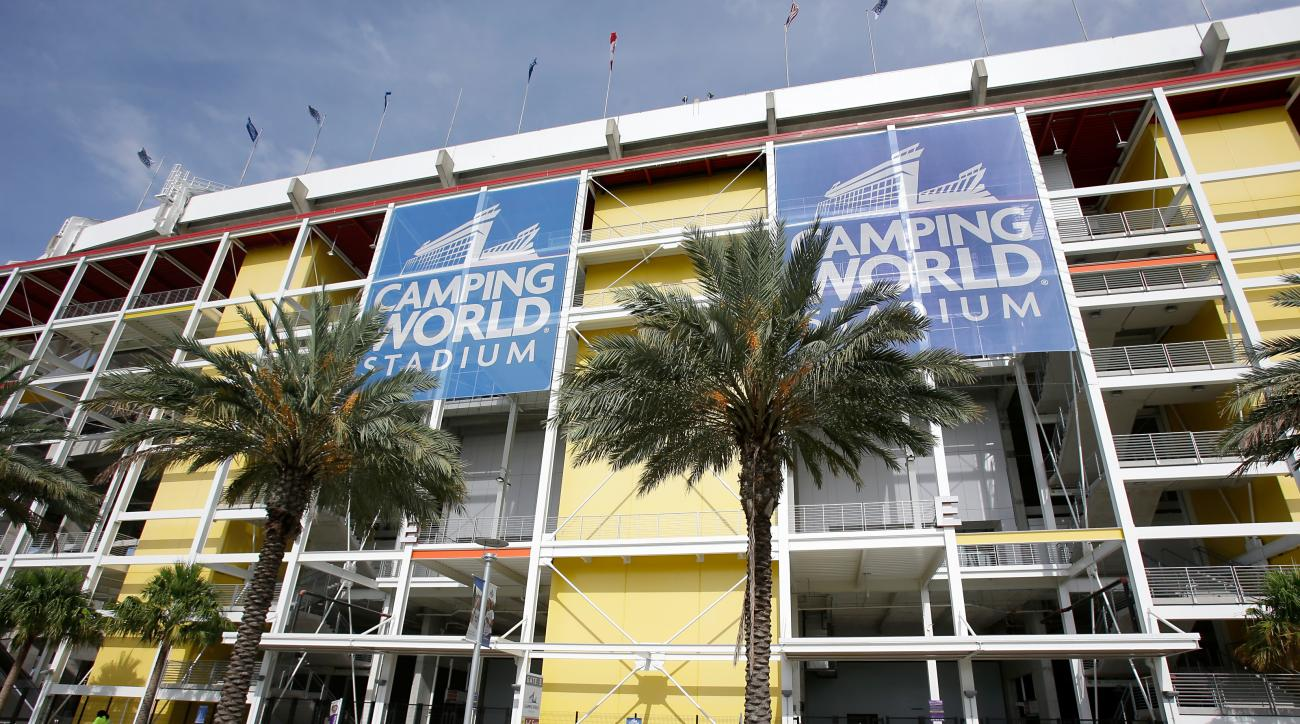 FILE - This Aug. 24, 2016, file photo, shows an exterior view of Camping World Stadium in Orlando, Fla. The Atlantic Coast Conference is moving its 2016 football championship to Orlando's Camping World Stadium, the ACC announced Thursday, Sept. 29, 2016.