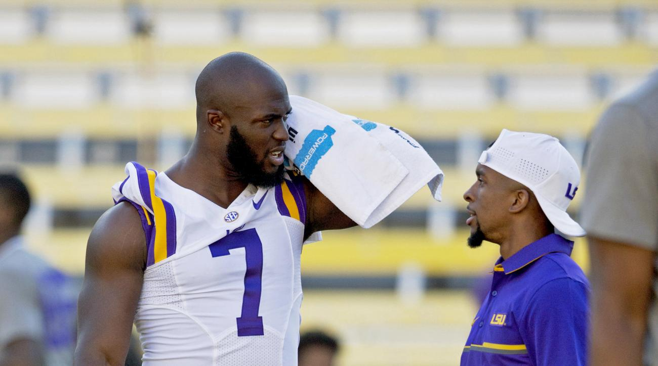 LSU running back Leonard Fournette (7) chats on the field before an NCAA college football game against Missouri in Baton Rouge, La., Saturday, Oct. 1, 2016. Fournette did not play. (AP Photo/Max Becherer)