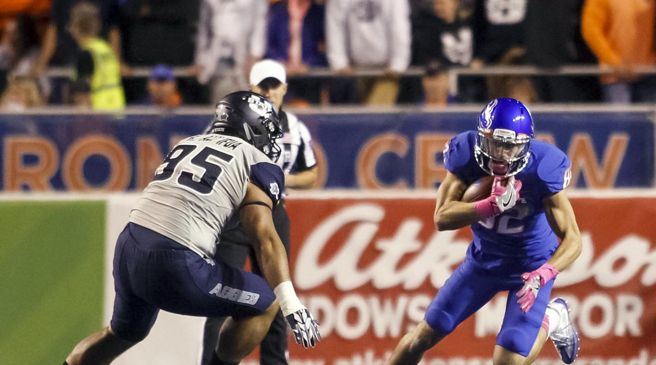 Boise State wide receiver Thomas Sperbeck (82) carries the ball against Utah State defensive end Ricky Ali'ifua (95) during the first half of an NCAA college football game in Boise, Idaho, Saturday, Oct. 1, 2016. Boise State won 21-10. (AP Photo/Otto Kits