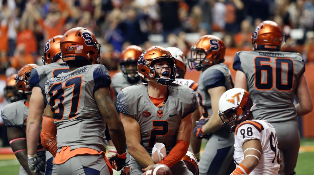 Syracuse quarterback Eric Dungey (2) celebrates after scoring a touchdown during the second half of an NCAA college football game against the Virginia Tech on Saturday, Oct. 15, 2016, in Syracuse, N.Y. Syracuse won 31-17. (AP Photo/Mike Groll)