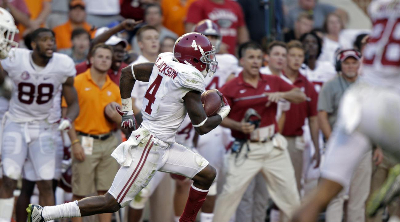 Alabama defensive back Eddie Jackson (4) returns a punt for a 79-yard touchdown during the second half of an NCAA college football game against Tennessee Saturday, Oct. 15, 2016, in Knoxville, Tenn. Alabama won 49-10. (AP Photo/Wade Payne)