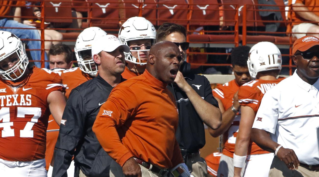 Texas head coach Charlie Strong calls out to his team during the first half of an NCAA college football game against West Virginia, Saturday, Nov. 12, 2016, in Austin, Texas. West Virginia won 24-20. (AP Photo/Michael Thomas)