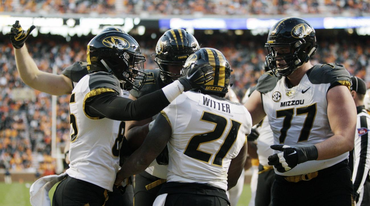 Missouri running back Ish Witter (21) is congratulated by teammates after scoring a touchdown during the first half of an NCAA college football game against Tennessee Saturday, Nov. 19, 2016, in Knoxville, Tenn. (AP Photo/Wade Payne)