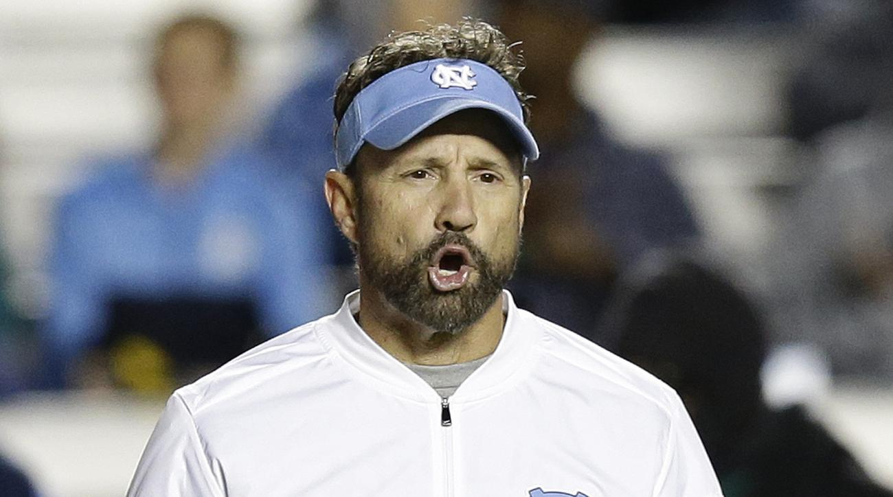 North Carolina head coach Larry Fedora speaks with an official during the second half of an NCAA college football game against The Citadel in Chapel Hill, N.C., Saturday, Nov. 19, 2016. North Carolina won 41-7. (AP Photo/Gerry Broome)