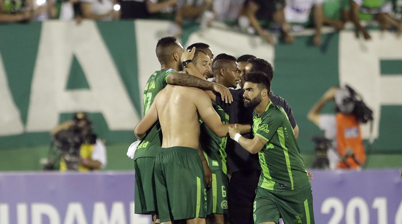 FILE - In this Wednesday, Nov. 23, 2016, file photo, players of Brazil's Chapecoense celebrate at the end of a Copa Sudamericana semifinal soccer match against Argentina's San Lorenzo in Chapeco, Brazil. A chartered aircraft with 81 people on board, inclu