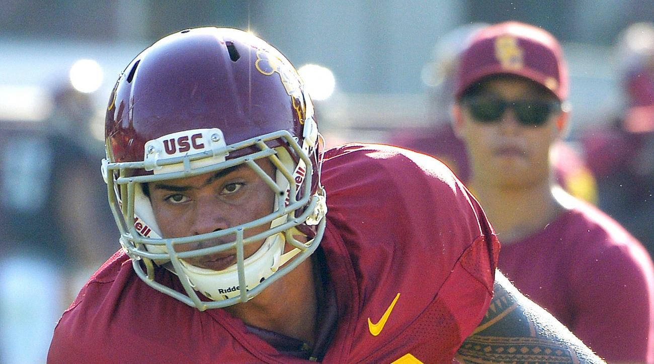 FILE - In this Aug. 30, 2016 file photo, Southern California's Osa Masina works out during NCAA college football practice in Los Angeles. Prosecutors in Utah plan to lay out evidence Monday, Dec. 12, 2016, against the suspended football player charged wit