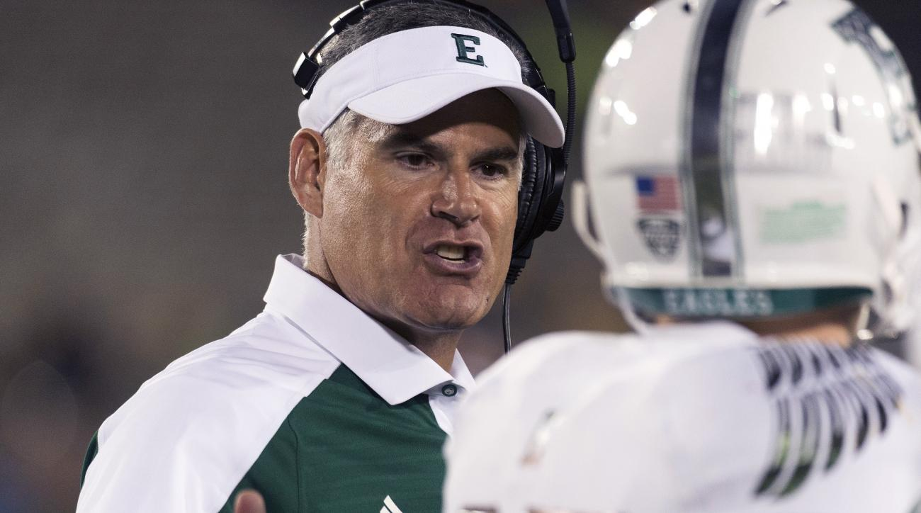 FILE- In this Sept. 10, 2016, file photo, Eastern Michigan head coach Chris Creighton, left, talks to wide receiver Mathew Sexton during the third quarter of an NCAA college football game against Missouri, in Columbia, Mo. Two years ago, it was hard to im
