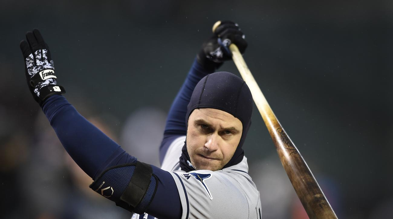 Tampa Bay Rays' Evan Longoria warms up during a rain delay in a baseball game against the Baltimore Orioles, Saturday, April 9, 2016 in Baltimore. (AP Photo/Gail Burton)