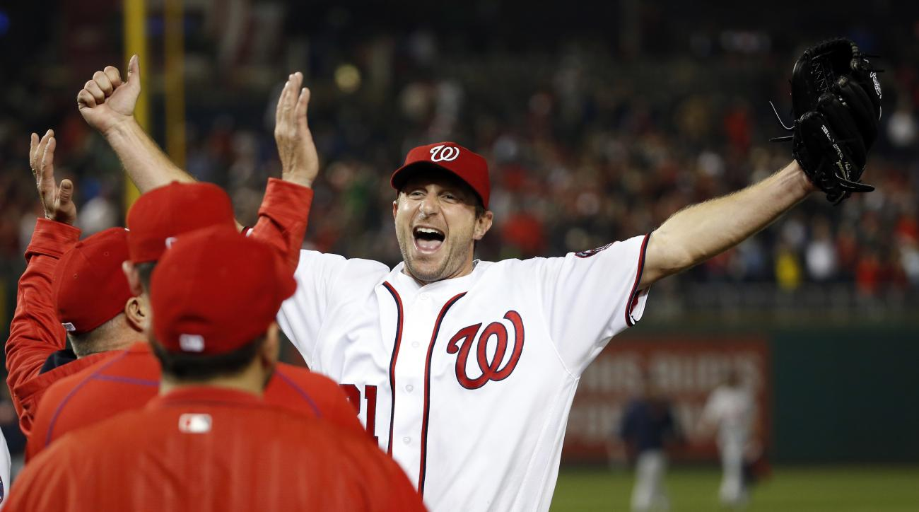 Washington Nationals starting pitcher Max Scherzer celebrates with his teammates after a baseball game against the Detroit Tigers at Nationals Park, Wednesday, May 11, 2016, in Washington. Scherzer struck out 20 batters, tying the major league nine-inning