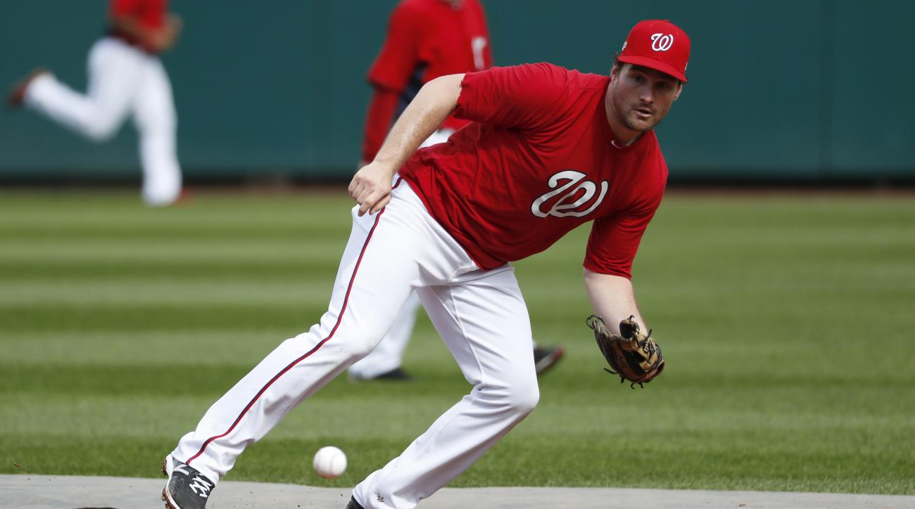 Washington Nationals second baseman Daniel Murphy goes after a ground ball during baseball batting practice at Nationals Park, Wednesday, Oct. 5, 2016, in Washington. The Nationals host the Los Angeles Dodgers in Game 1 of the National League Division Ser