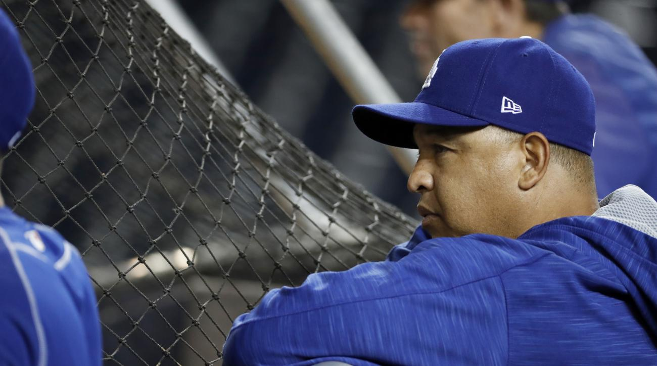 Los Angeles Dodgers manager Dave Roberts watches his team during baseball batting practice at Nationals Park, Wednesday, Oct. 5, 2016, in Washington. The Nationals host the Los Angeles Dodgers in Game 1 of the National League Division Series baseball game