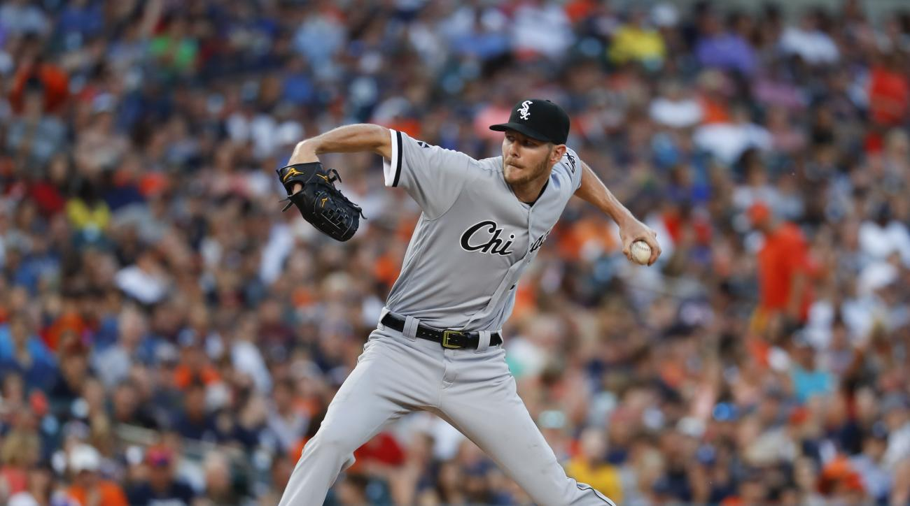 FILE - In this Aug. 3, 2016, file photo, Chicago White Sox pitcher Chris Sale throws against the Detroit Tigers in the fifth inning of a baseball game, in Detroit. The Atlanta Braves may not be finished with the dramatic overhaul of their rotation. Braves